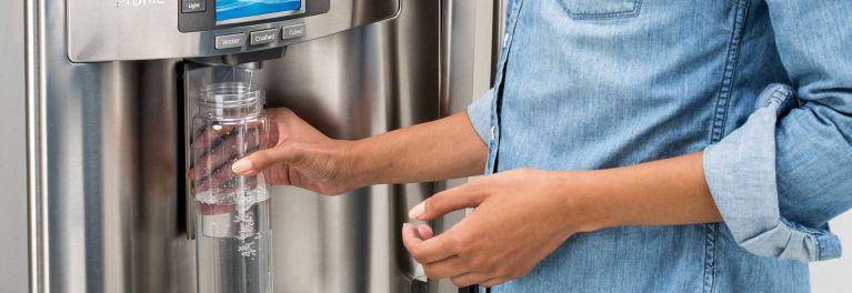 A refrigerator water dispenser.