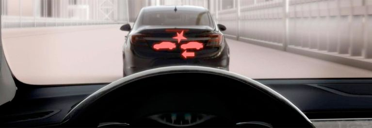 Photo of a pending collision warning, one of the many advanced safety systems that car manufacturers are adding to vehicle models as standard features.