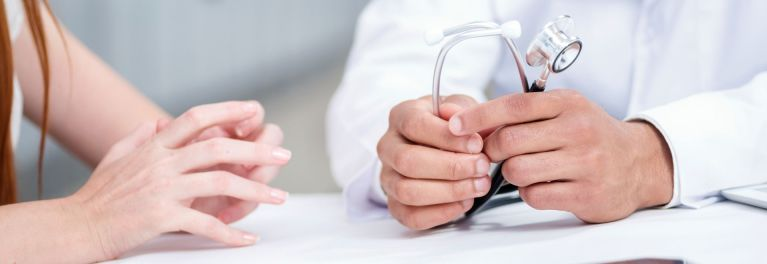 This image shows a patient talking with her doctor. It's important to discuss issues so you can fix problems in your doctor patient relationship.