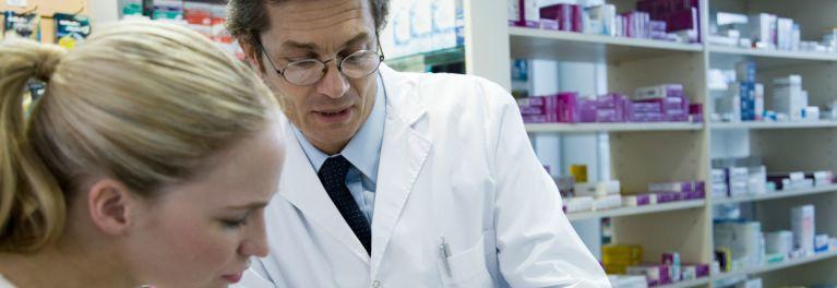 Prescriptions:Man and Woman filling prescriptions in a pharmacy.