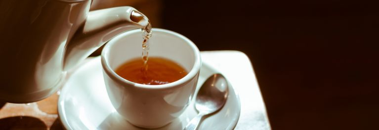 This shows tea being poured into a cup. Coffee, tea, hot cocoa and other hot beverages may have health benefits.