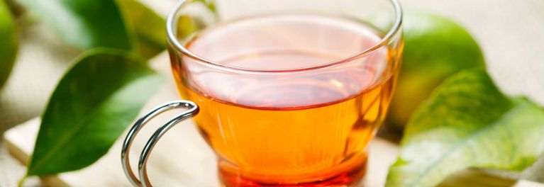 A clear glass cup of tea. There are many health benefits of tea.