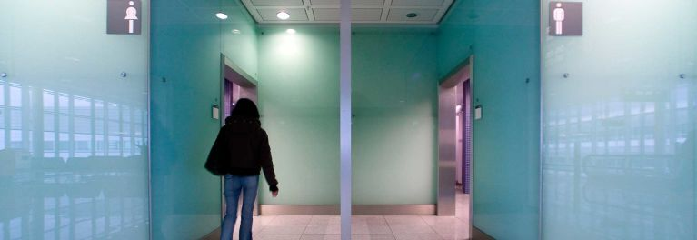 Bladder leaks: woman rushing to the bathroom