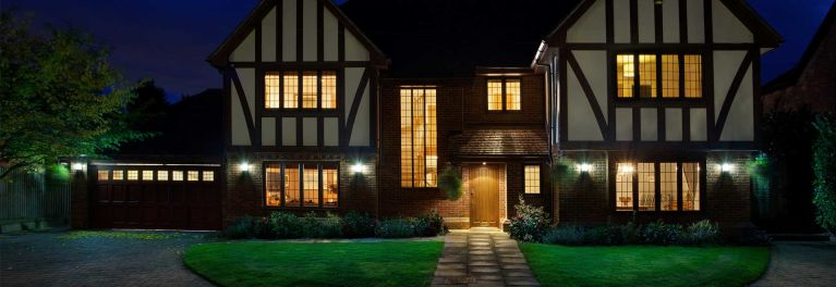 BeON Home Protection System on house at night.