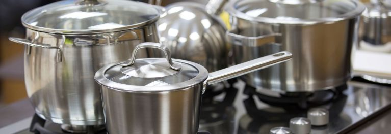 Set of stainless steel cookware care.