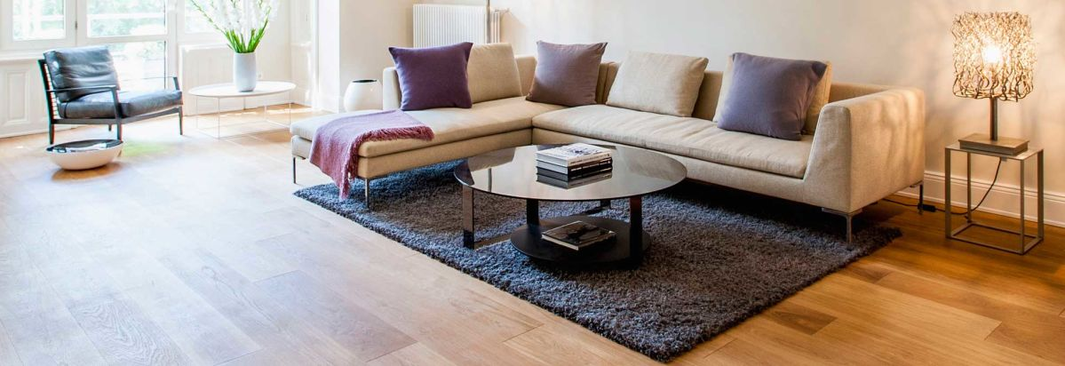 a living room with tile flooring that looks like wood - Wood Tile Living Room