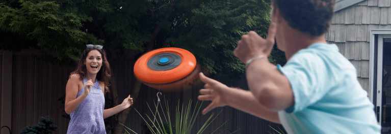 Two people tossing a Disk Jock-e frisbee