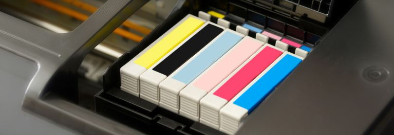 A close-up of printer ink cartridges.