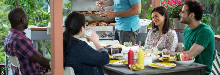 People enjoying a summer cookout.