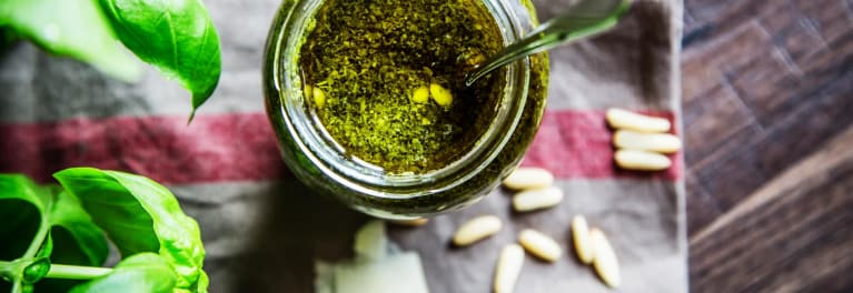A jar of pesto, a healthy packaged food.
