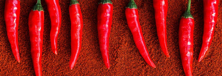 Hot peppers are spicy foods.