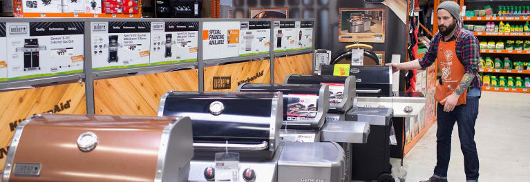 Gas grills on display at Home Depot.