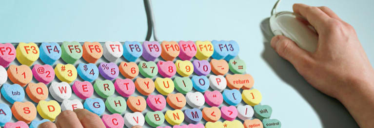 A keyboard with Valentine's candy as keyboard keys to illustrate romance spam.