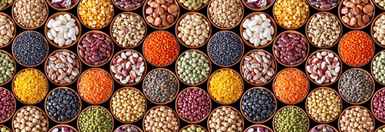 You can get the health benefits of fiber from whole grains and beans and peas, pictured here.