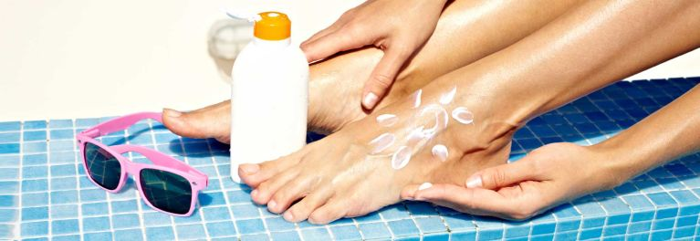 Sunburn protection includes covering feet, lips and scalp.