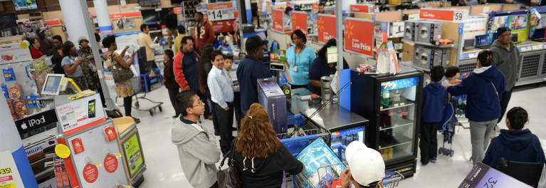 Photos of shoppers inside a Walmart store.
