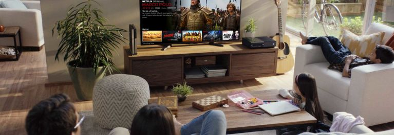 For an article on 4K content with HDR being offered by Netflix, this photo shows a family watching TV together