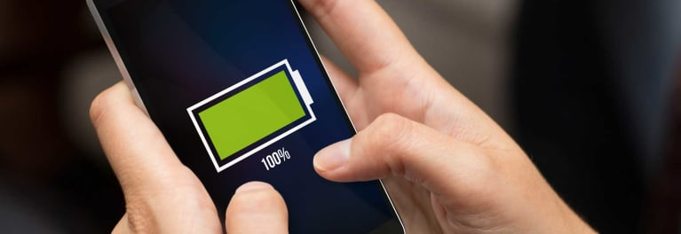 A woman's phone about to die for article on how to maximize your smartphone battery life.