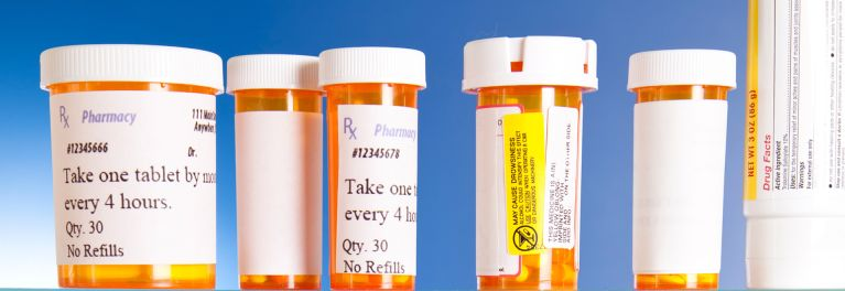 Where do you keep Prescription Pain Relievers? Image of prescription pill bottles in medicine cabinet.