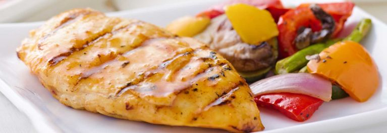 Chicken breast with vegetables. Getting more fruits and vegetables is important.