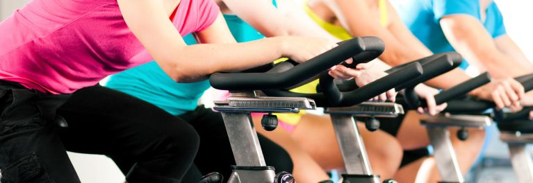 Skin infections: People at the gym on exercise bikes.