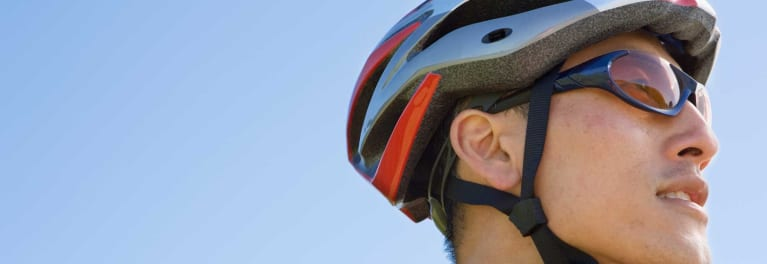 Man wearing a bike helmet. Helmet care is an important part of bike safety.