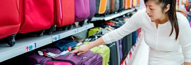 A woman about to buy luggage