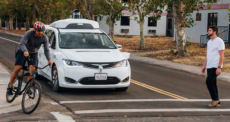 Waymo Castle van yielding for bicyclist and pedestrian