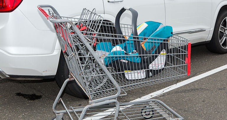 Infant car seat in shopping cart