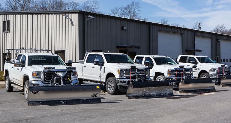 Heavy-duty pickup trucks with snow plows