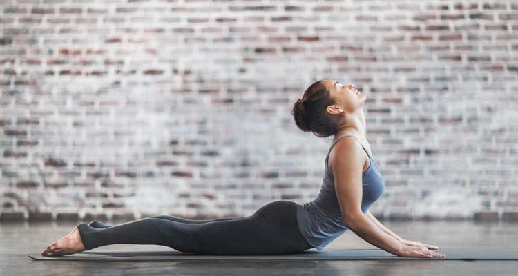 Cobra, a pose to try when using yoga for back pain.
