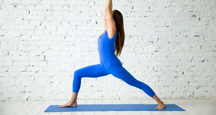 Warrior One, a pose to try when using yoga for back pain.