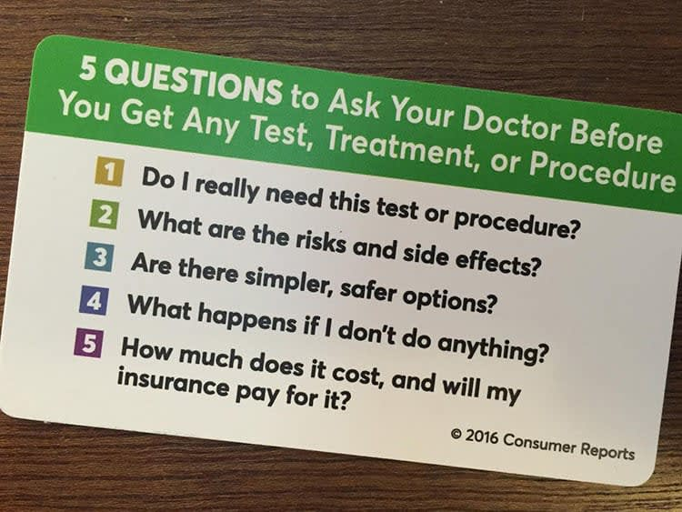 Picture of somone holding an Ask Your Doctor card.