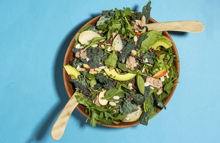 A superhero salad with mixed greens, almonds, avocados, and more