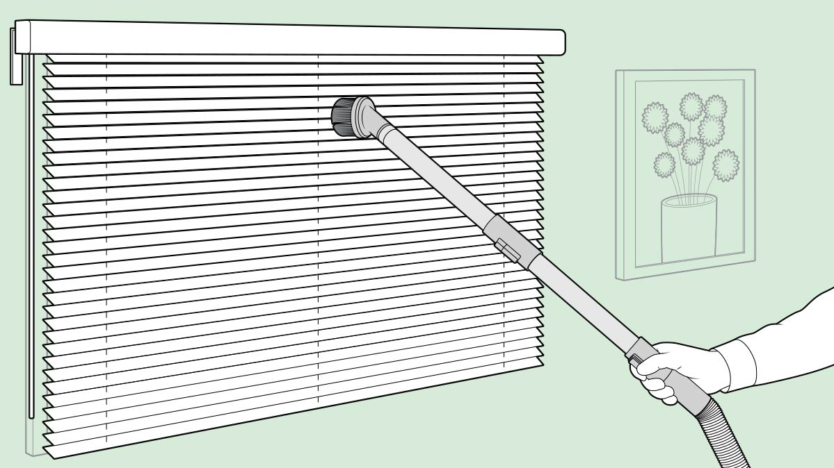 Illustration of a person using a vacuum attachment on window blinds.