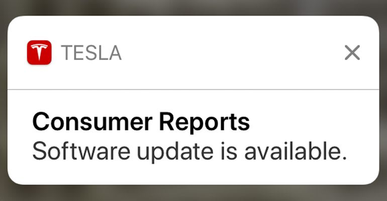 iPhone lock screen showing available update for Tesla car.