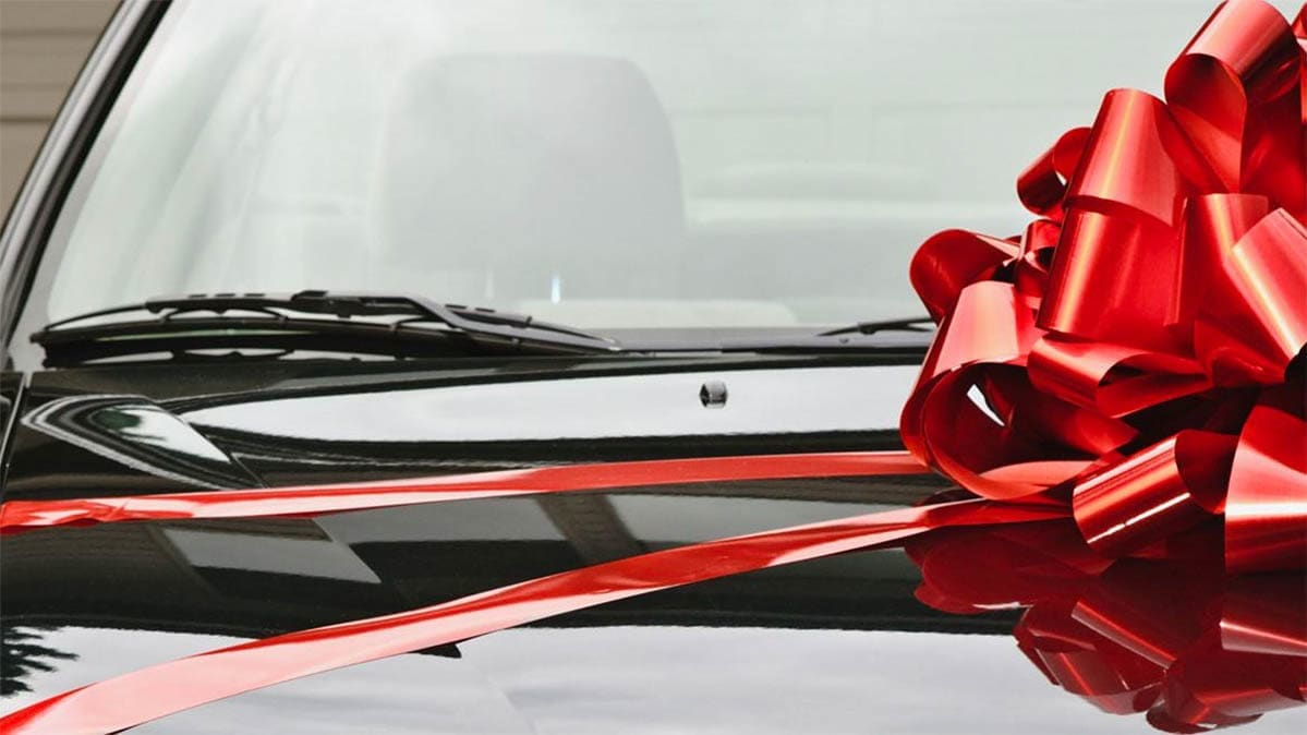 Gifts for car lovers, including a car with a bow.