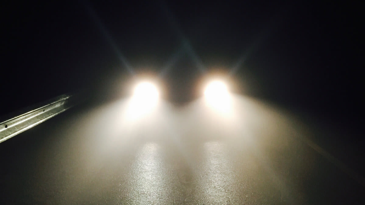 Headlights on a road.