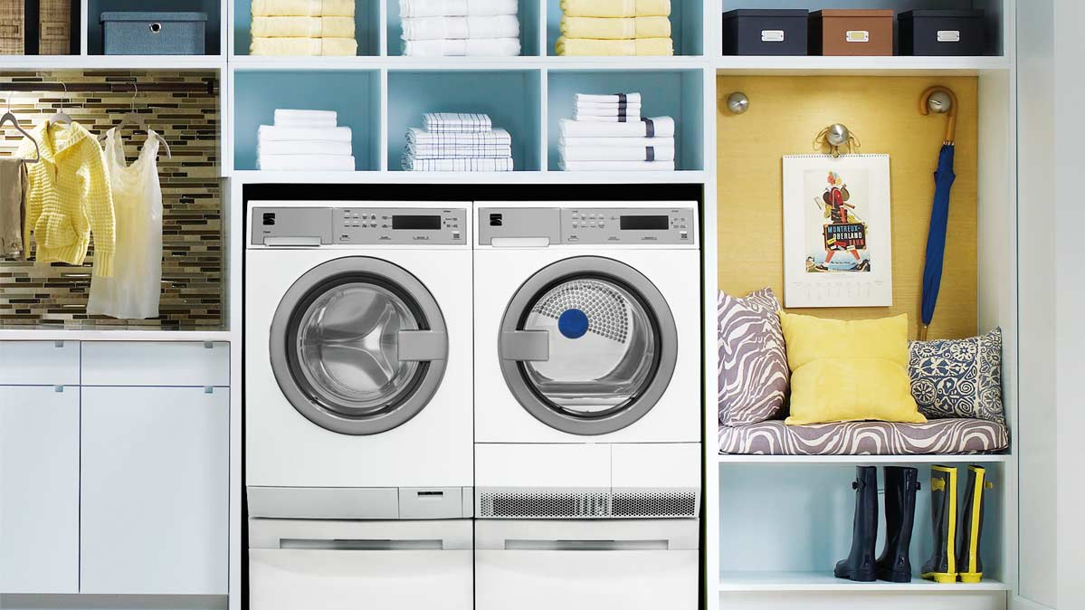 A compact washer and dryer in a laundry/mud room.