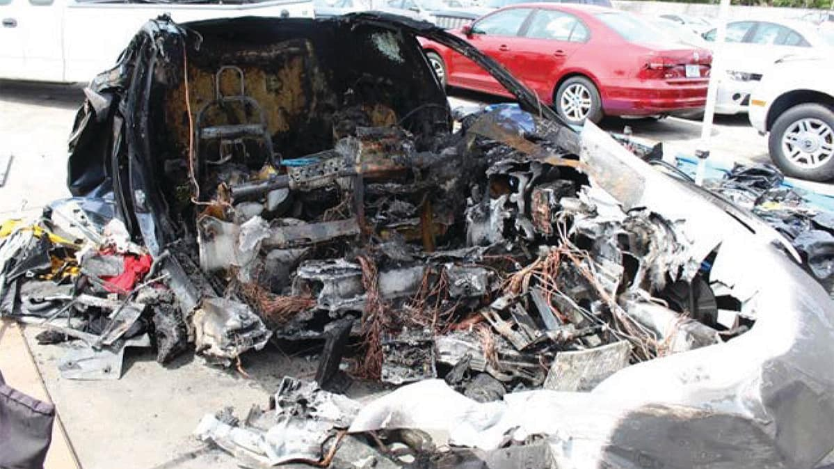 A crashed and burnt-out Tesla Model S.
