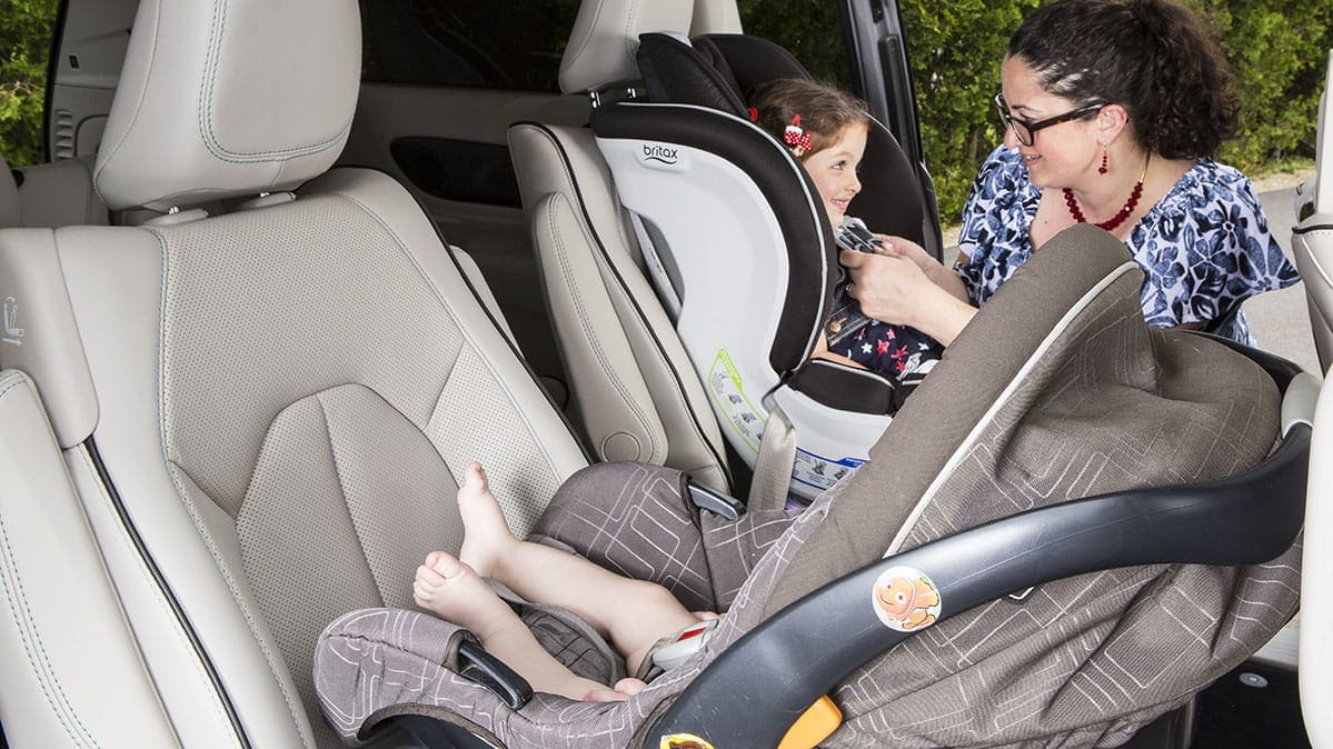 Children being secured in car seats