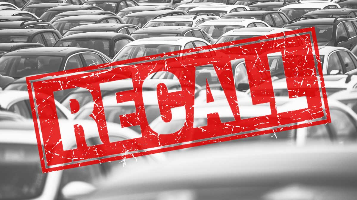A photoillustration depicting a used car recall