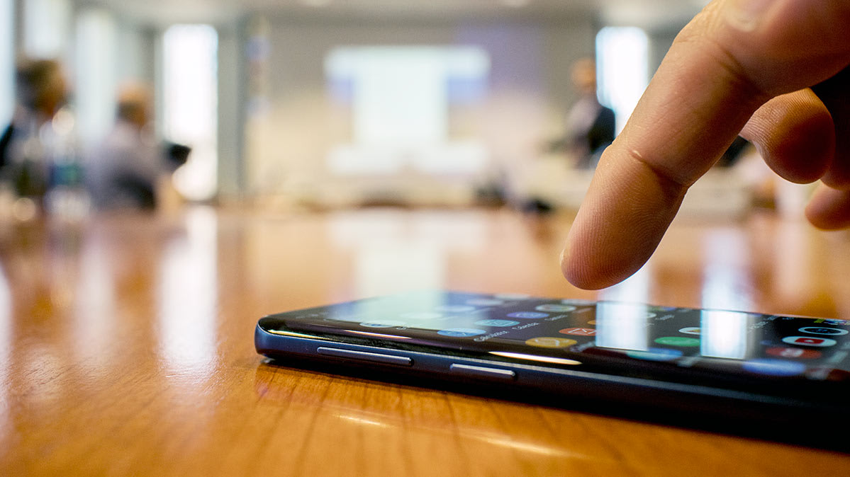 Samsung galaxy s9 on a conference room table.