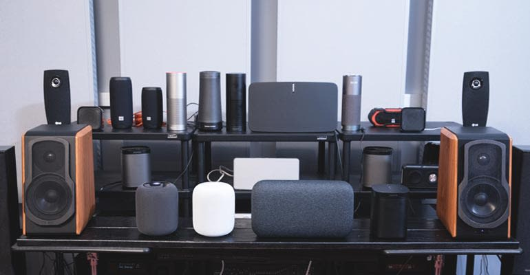 Apple HomePod, Google Home Max, Sonos One, and other speakers in the Consumer Reports listening lab.
