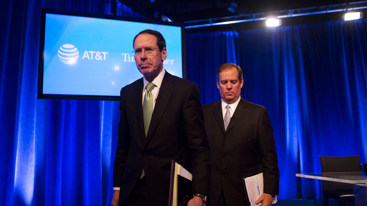 AT&T CEO Randall Stephenson and general counsel David R. McAtee II.