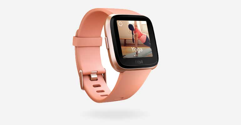a Fitbit Versa with a pink band and a yoga app on the screen