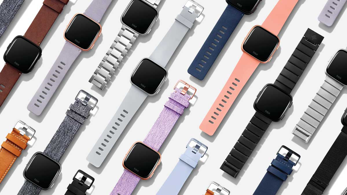 more than a dozen Fitbit Versa smartwatches with different bands