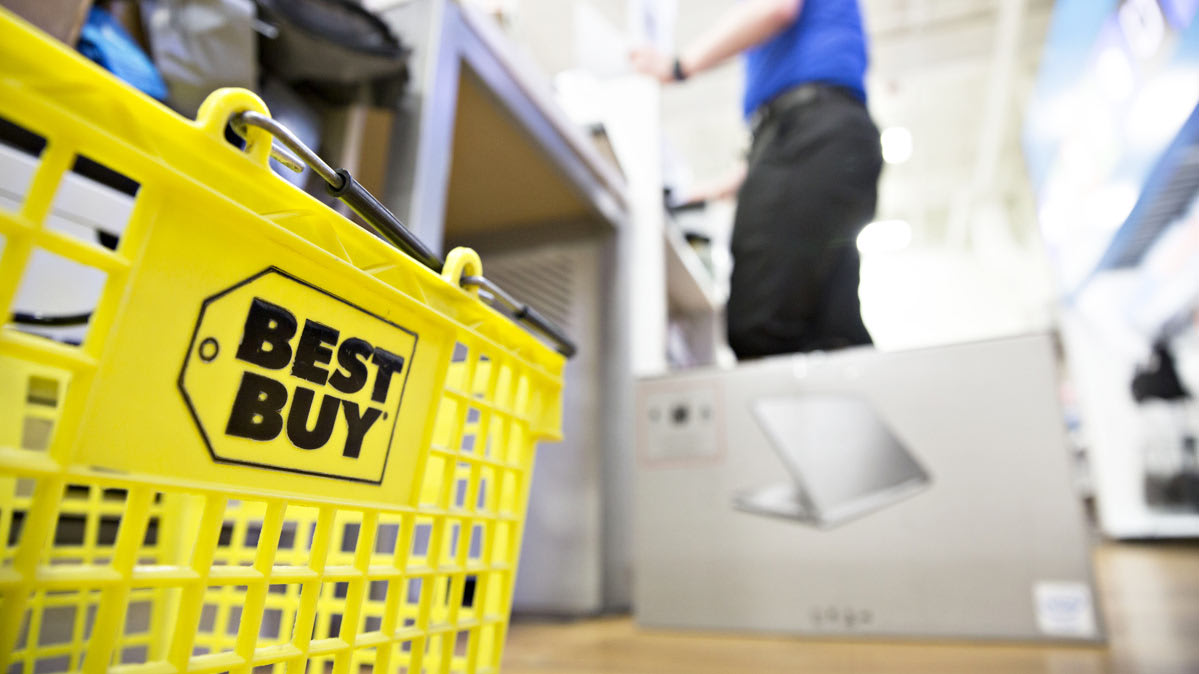 A Best Buy shopping basket neat a checkout aisle.