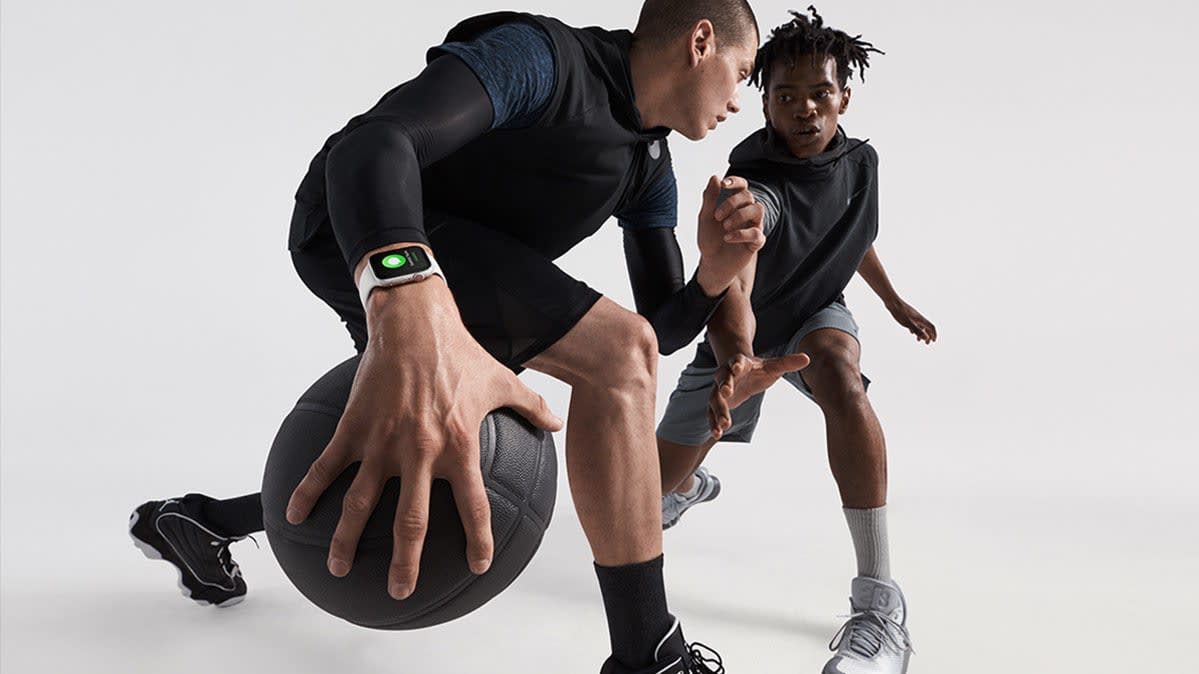 Two men play basketball while wearing Apple Watch Series 4