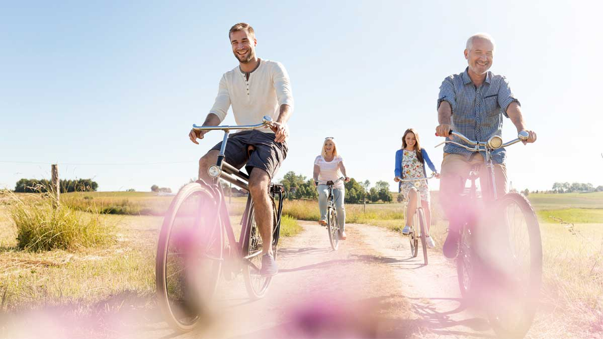 A family cycling together. Exercise is good for people with a family history of heart disease.